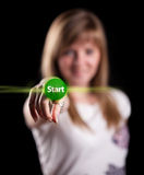 Woman pressing START button Royalty Free Stock Photos