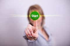 Woman pressing start button. With one hand Royalty Free Stock Photos