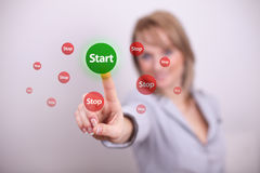 Woman pressing start and stop button Stock Photo