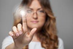 Woman pressing touchscreen button Stock Photos