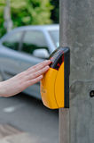Pressing the yellow crosswalk button Royalty Free Stock Images