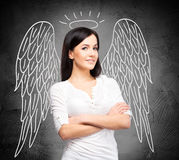 Woman pretending to be an angel Stock Images
