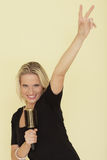 Woman pretending to be a rock star Royalty Free Stock Photography
