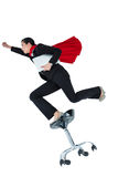 Woman pretending to be a super hero. On white background royalty free stock photo