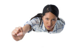 Woman pretending to be a superwoman against white background Stock Photography