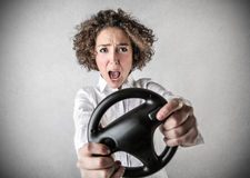 Woman pretending to drive Royalty Free Stock Image