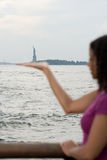 Woman pretending to hold statue of liberty Stock Photography