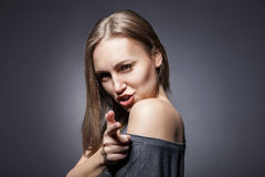 Woman pretending to shoot with her finger Stock Image