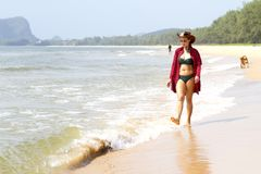 Woman pretty bikin and hat relax daylight on beach. At Bang Beot beach, Chumphon Province Thailand Royalty Free Stock Image
