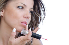 Woman with pretty face do her makeup , isolated on white Royalty Free Stock Photo