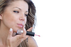Woman with pretty face do her makeup , isolated on white Royalty Free Stock Photography