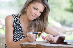 Woman with pretty face do her makeup outside Royalty Free Stock Image