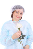 Woman. Pretty young doctor with the white flower royalty free stock image