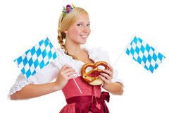 Woman with pretzel and bavarian flag Royalty Free Stock Photos
