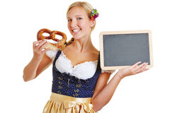 Woman with pretzel and empty blackboard Stock Photos