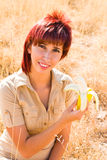 Woman Prevent osteoporosis. Avoid osteoporosis and eat bananas Stock Photo