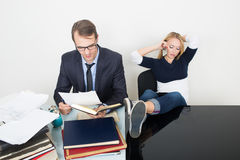 Woman prevents a man to work. talking phone. It Stock Images