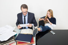 Woman prevents a man to work. talking phone. It Royalty Free Stock Photo
