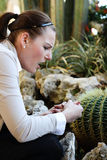 Woman pricked herself on a thorn from a cactur Royalty Free Stock Photo