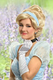 Woman in Princess Costume in Garden stock images