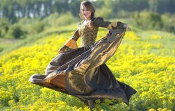 Woman on Princess Costume Waving Her Dress on Green Flower Fields Stock Photos