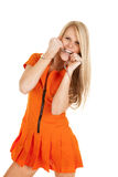 Woman prisoner orange bite handcuffs Stock Images