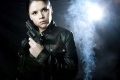 Woman Private investigator. Holding a gun, mystery movie setting stock images