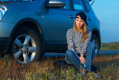 Woman and problem car. Frustrating young woman with wrench near broken car Royalty Free Stock Photos