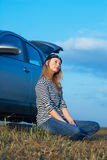 Woman and problem car. Frustrating young woman with wrench near broken car Royalty Free Stock Photo
