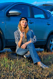 Woman and problem car. Frustrating young woman with wrench near broken car Royalty Free Stock Photography