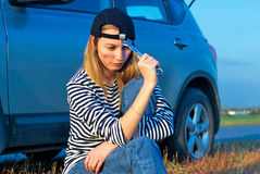 Woman and problem car. Frustrating young woman with wrench near broken car Stock Photography
