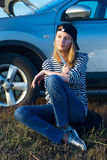 Woman and problem car Stock Image
