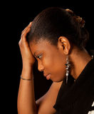 Woman with problems. Wet tears running of the face of a young african woman Stock Photo