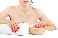 Woman at procedures in the spa salon. isolated Stock Photos