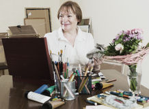 Woman  in the process of painting Stock Image