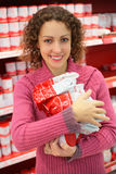 Woman with products in shop Royalty Free Stock Photo