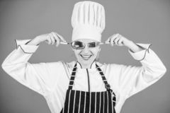 Woman professional chef hold utensil spoon fork having fun. Time to eat. Appetite and taste. Traditional culinary. Professional cook of culinary school royalty free stock image