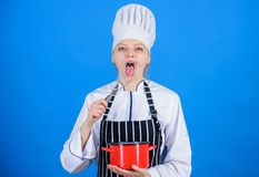 Woman professional chef hold whisk and pot. Whipping like pro. Girl in apron whipping eggs or cream. Start slowly royalty free stock images