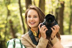Woman is a professional photographer with photo camera royalty free stock photo