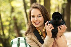 Woman is a professional photographer with photo camera royalty free stock images