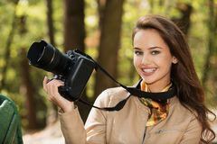 Woman is a professional photographer with photo camera stock photography