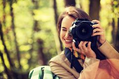Woman is a professional photographer with photo camera royalty free stock photography