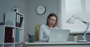Woman professional using laptop sit at office desk, happy female customer make confirming online website. stock video footage