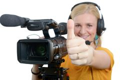 Woman with professional video camera,showing thumbs up. A blond young woman with professional video camera, showing thumbs up Royalty Free Stock Image