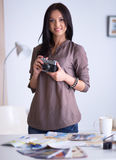 Woman is a proffessional photographer with camera Stock Photography