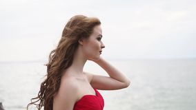 Woman profile in background of sea in windy summer day, close-up stock video