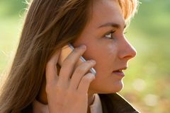 Woman In Profile On Cell Phone Stock Image