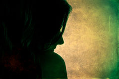 Woman profile silhouette in dark. Green background. Stock Photos