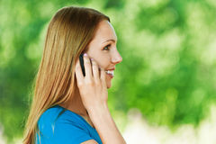 Woman in profile to your phone Stock Photos