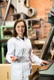 Woman programming process inside factory Royalty Free Stock Image